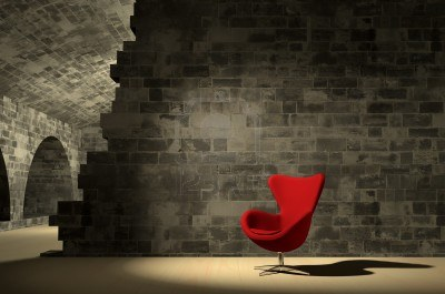 Red-modern-chair-in-ancient-surroundings