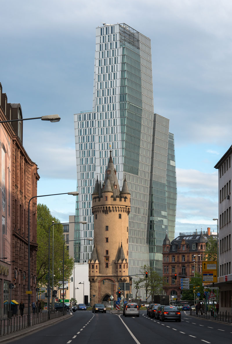 Old-tower-in-front-of-modern-high-rise-frankfurt-germany-1