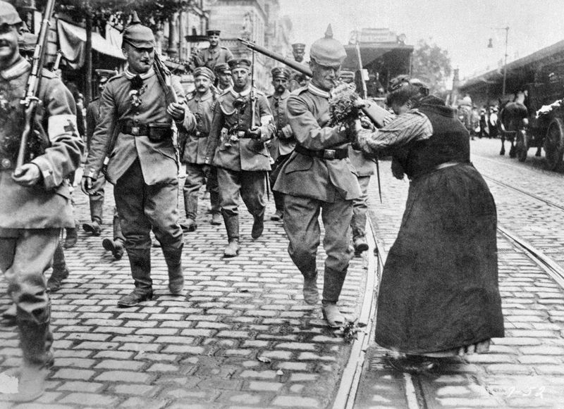 A woman gives flowers to a German soldier leaving for the front, Berlin, August 1914